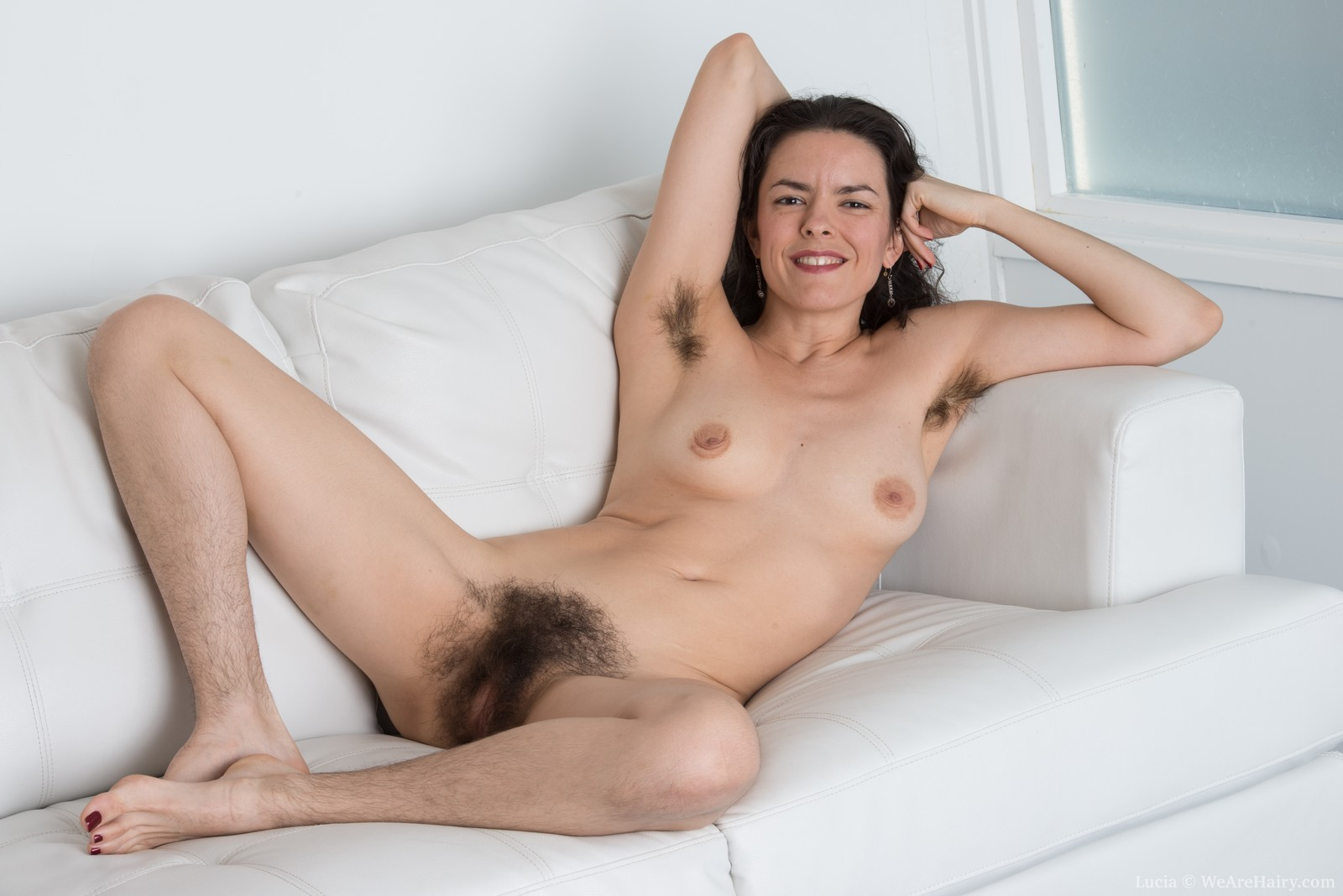 Sunshine strips naked to show off very hairy body