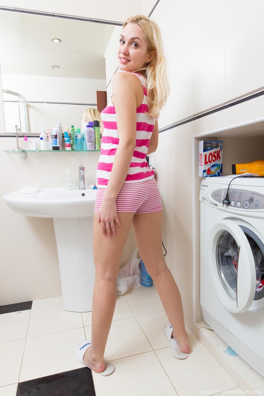 Washing laundry nude girl